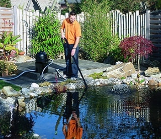 Pond Vaccumm in use.