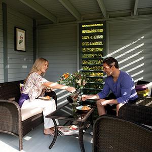 Couple enjoying a drink inside a cabin