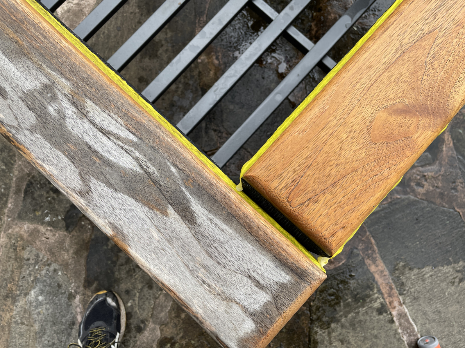 This image shows one part of a teak chair before cleaning, and one part after cleaning with Barlow Tyrie's teak cleaner.
