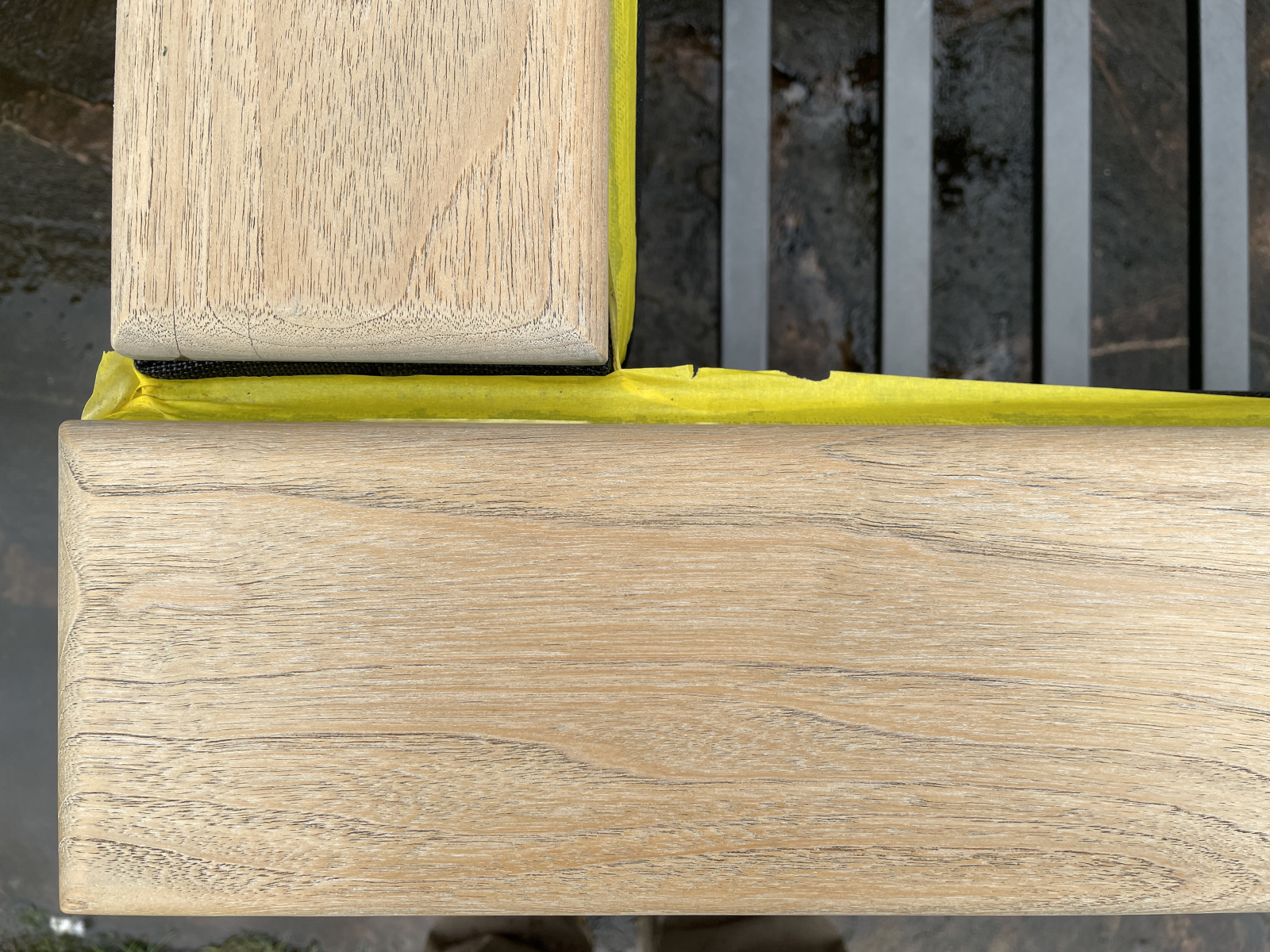 A close up view after using Barlow Tyrie's teak cleaner.