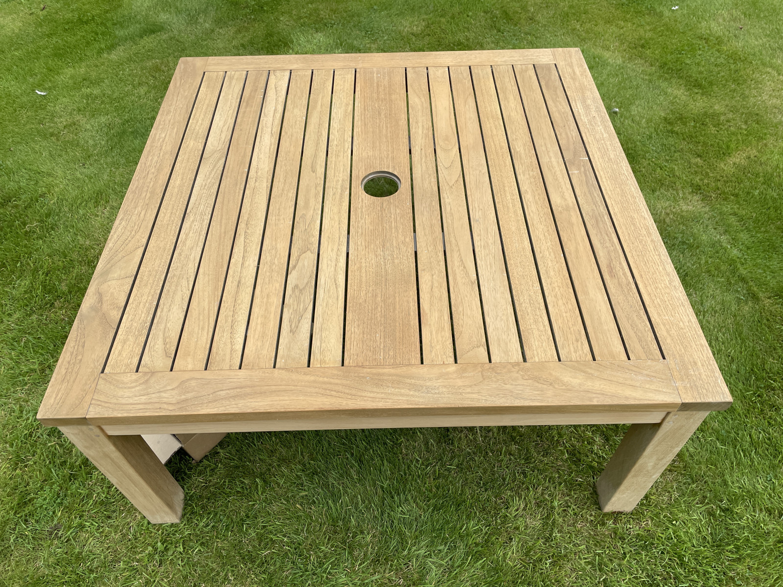 A teak table after being cleaned, colour guarded, and wasp protected.