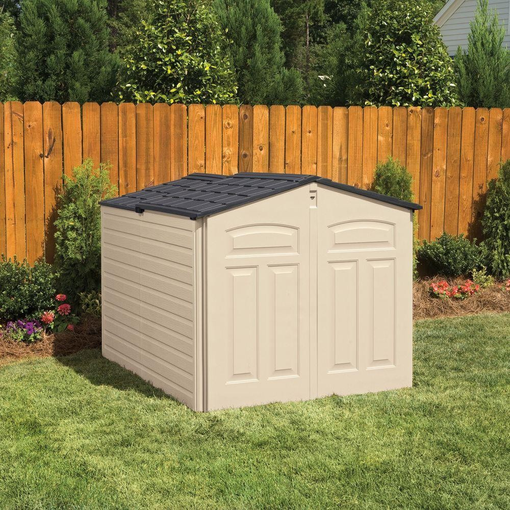 The low height sliding roof Rubbermaid shed in a garden.