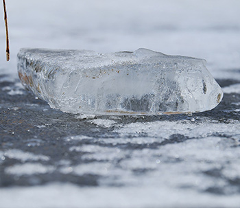 chunk of ice on frozen pond