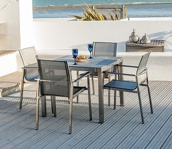 Cologne Stainless steel 90cm square table with grey ceramic top and four graphite stacking chairs