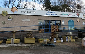 Photo of the outside of our Aquatics superstore. With water features on display