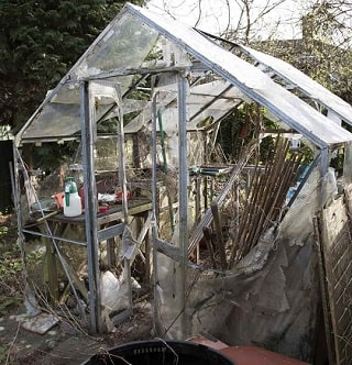 Damaged greenhouse due to storm and extreme winds.