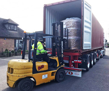 Unloading Henri Studio delivery.