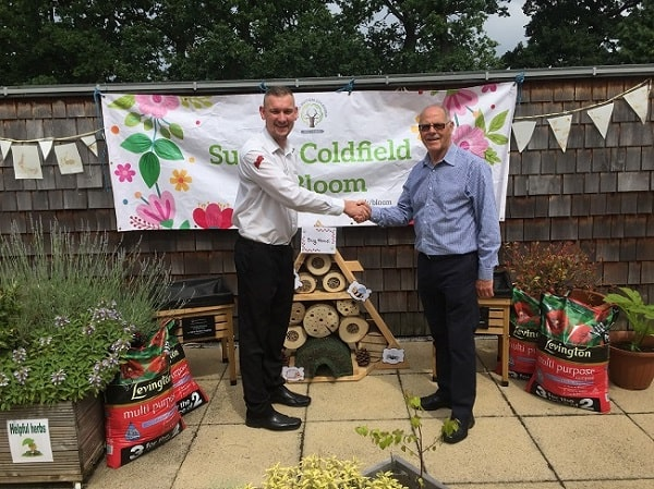 Partner David Coton shaking the hands with the Chairman of the Sutton Coldfield in Bloom working group.
