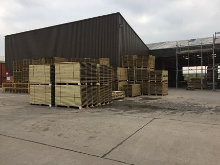pallets of timber in a warehouse yard