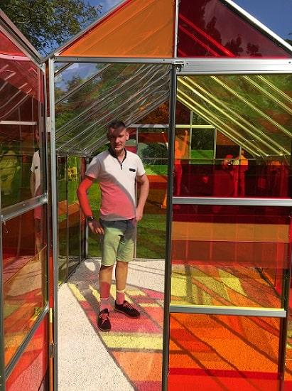 Partner David Coton Inside an Acrylic Greenhouse
