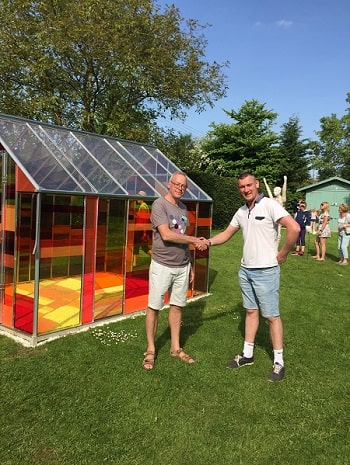 Partner David Coton with Designer Julian Bull in front of an acrylic panelled greenhouse
