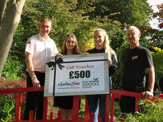 Partners David Coton, David hall and staff members with a £500 voucher for Food Growing Schools.
