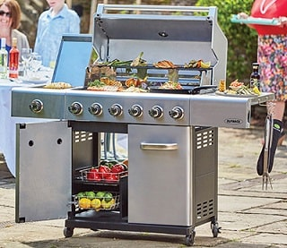 open stainless steel gas barbecue with food on top