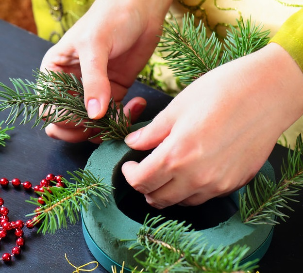A Christmas wreath being handmade.