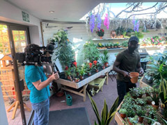 Filming taking place in gardencentre.