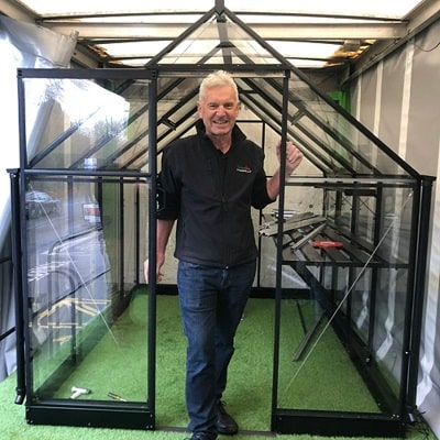 Partner Rober Hall with an Eden Greenhouse